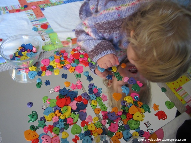 reggio-activities-for-toddlers-using-mirrors-and-buttons-2